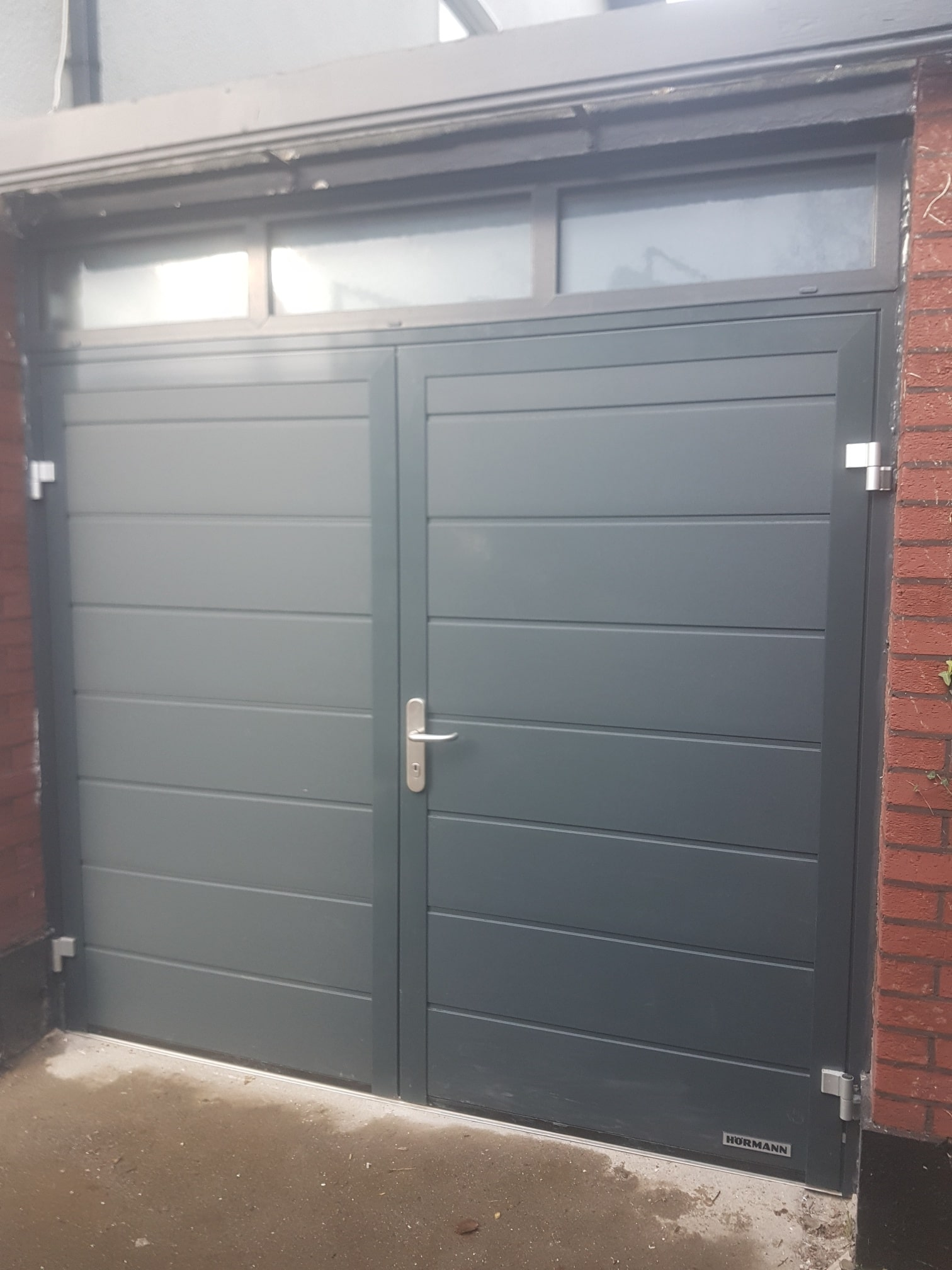 Insulated side hinged garage doors 1