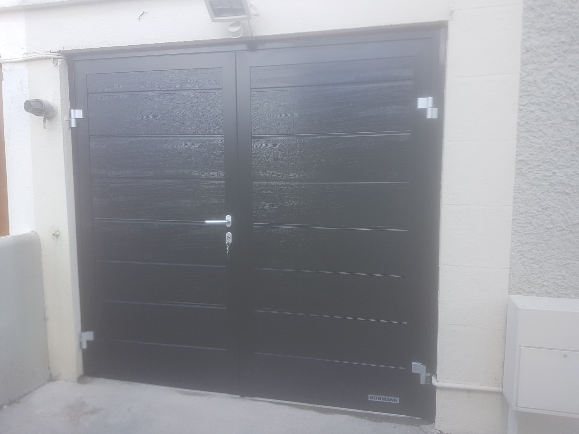 Insulated side hinged garage doors 3